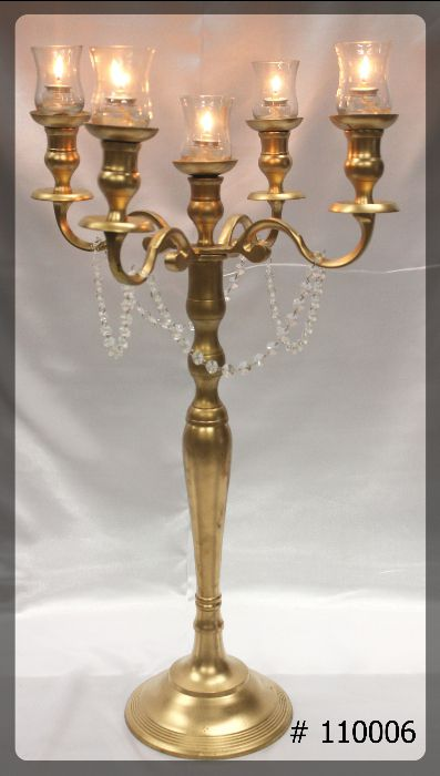 gold candelabra 33 inch tall with glass votives and 8 hour candles
