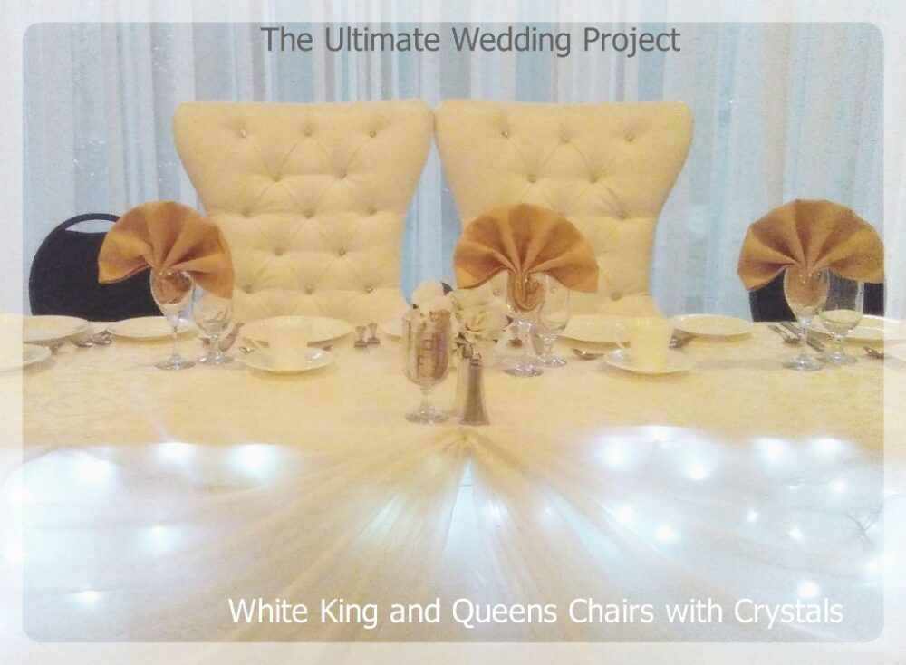 Bride and Groom White chairs. Toronto, Ontario, Canada.