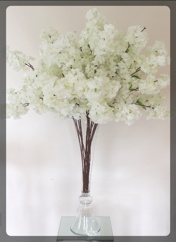 Cherry Blossoms on a clear tall vase 50 inch tall