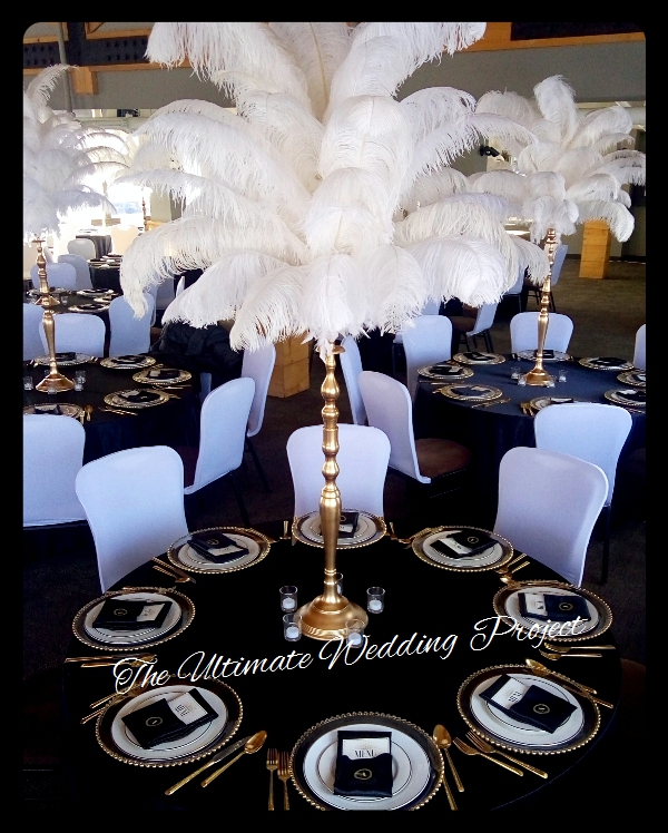 ostrich feather centerpieces gold stand