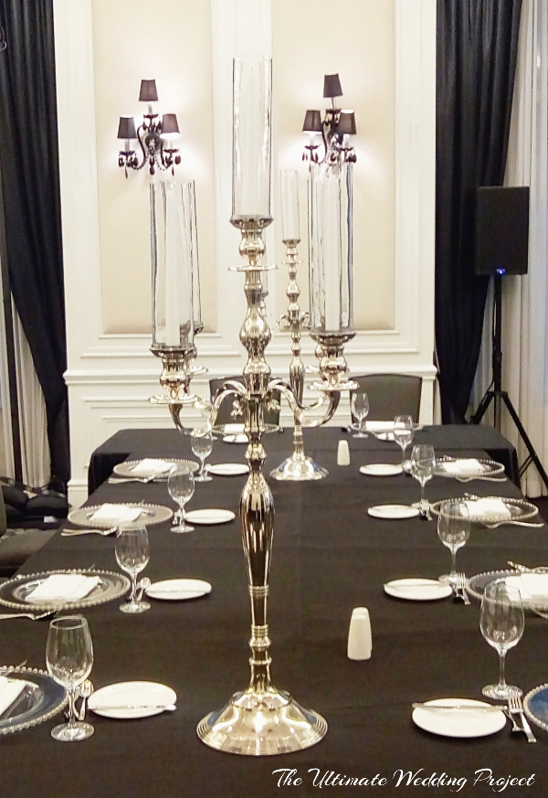 Silver Candlebara tall with clear tall glass and taper candles