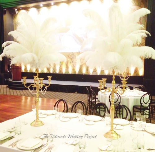 Gold Candelabra with white Ostrich feathers