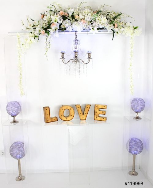 Ghost arch with faux florals, crystal globes and love letters 80x90