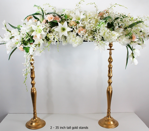 Floral arrangement for parents tables with our gold stands 35 inch tall