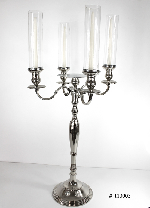 Silver Candelabra with tall taper candles and tall glass hurricanes with plate for florals in the middle 38 inch tall # 113003