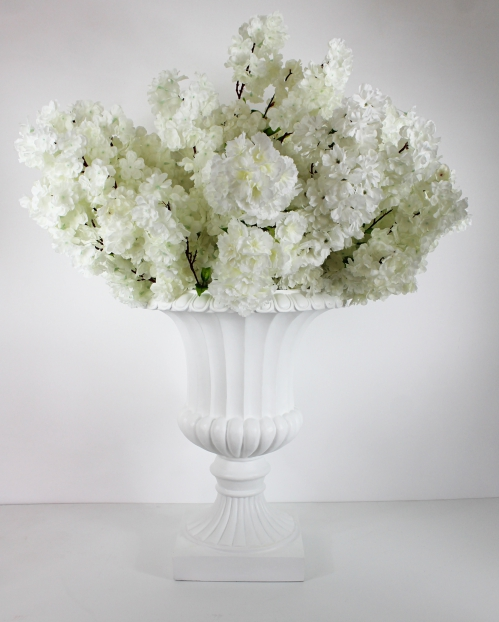 white cherry blossom centerpiece on a white planter total 45 inches tall