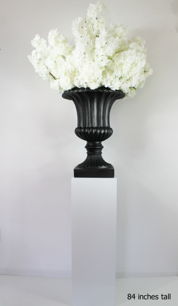 white cherry blossom centerpieces on a black planter and white pedestals 84 inches tall