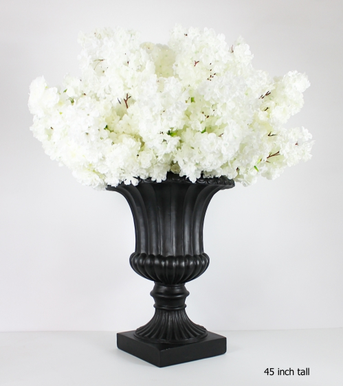 white cherry blossoms on a black planter 45 inch tall