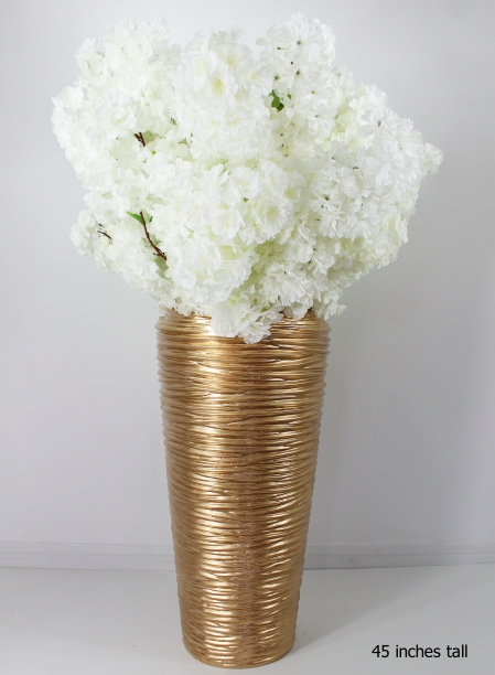 white cherry blossoms on a gold plater with a total height of 45 inches