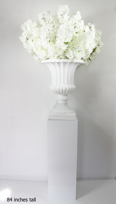 white cherry blossoms on a white planter and white pedestal 84 inches total height